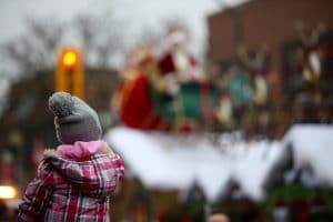 Young Girl watches the Santa Claus Parade